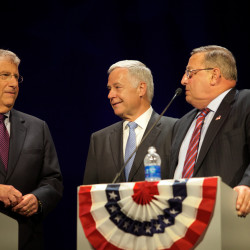 Candidates for governor -- independent Eliot Cutler (from left), Democratic U.S. Rep. Mike Michaud and incumbent Republican Gov. Paul LePage -- greet each other on stage before a televised debate in Augusta on Oct. 15, 2014.