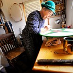 "J.J. Starwalker works on one of her Dutch hex signs in her home studio in West Corinth October 29, 2009. In keeping with hex sign making tradition, she wears a hat to &quotcover thy head in the presence of the divinity, "" she said. BANGOR DAILY NEWS PHOTO BY JOHN CLARKE RUSS"