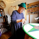 "Artist J.J. Starwalker works on one of her Dutch hex signs in her home studio in West Corinth October 29, 2009. In keeping with hex sign making tradition, she wears a hat to &quotcover thy head in the presence of the divinity, "" she said.  BANGOR DAILY NEWS PHOTO BY JOHN CLARKE RUSS"